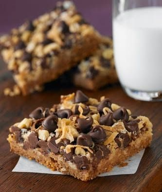 Magic Cookie Bars ~ This bar cookie is an old fashioned favorite. Chocolate chips, nuts and coconut are set in a caramelized layer on top of a graham cracker crust..