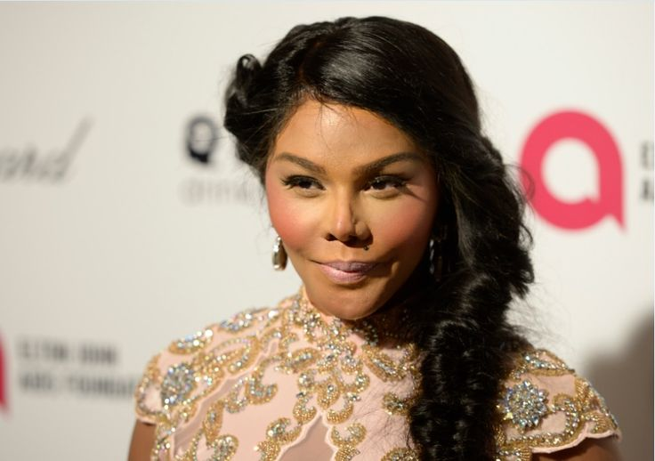 Did Lil' Kim have cosmetic surgery?