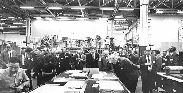 In March 1970, NASA center directors and their staff members visited the St. Louis facility of the McDonnell Douglas Astronautics Co. to review progress on Skylab. Left to right are Thompson, Christopher C. Kraft, Jr., Thomas W. Morgan, Faget, Ludie G. Richard (behind Faget), unidentified, Walter Burke, Sigurd A. Sjoberg, F. Brooks Moore, Eberhard Rees, Kenneth S. Kleinknecht, Lee B. James, T.J. Lee, Leland F. Belew, Floyd M. Drummond, and Fred A. Speer.