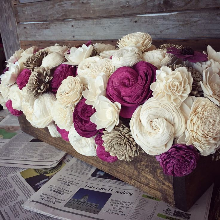 This flower bed centerpiece comes assembled with three colors.White and brown are included with a third color of your choice. In this photo, purple