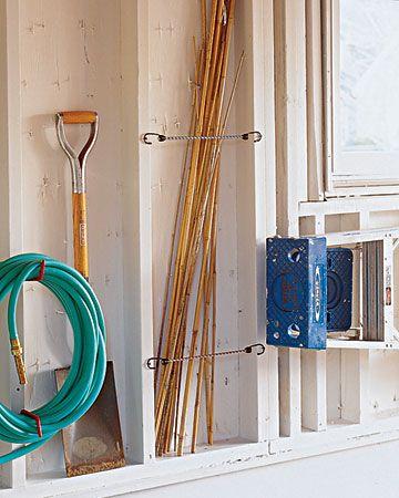 Garage organization...bungees for tiki torch storage