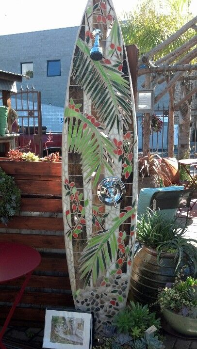 Outdoor shower in a mosaic surfboard... it is absolutely beautiful in person.