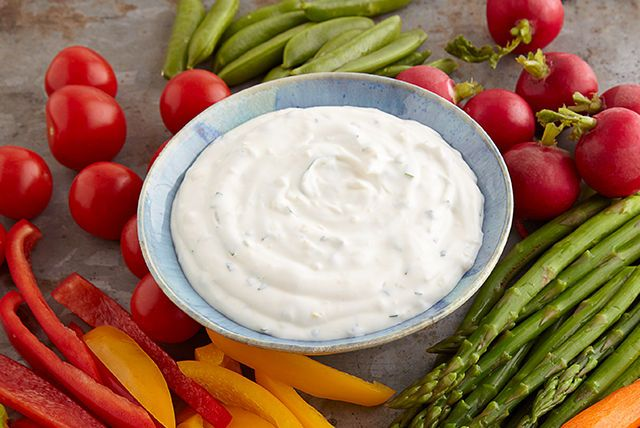 Lemon Herb Aioli Dip - Lemon, basil and garlic are all this mayonnaise and sour cream mixture need to create the perfect party dip.