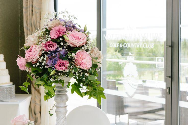 Vintage pink floral arrangements by Floral Dreams