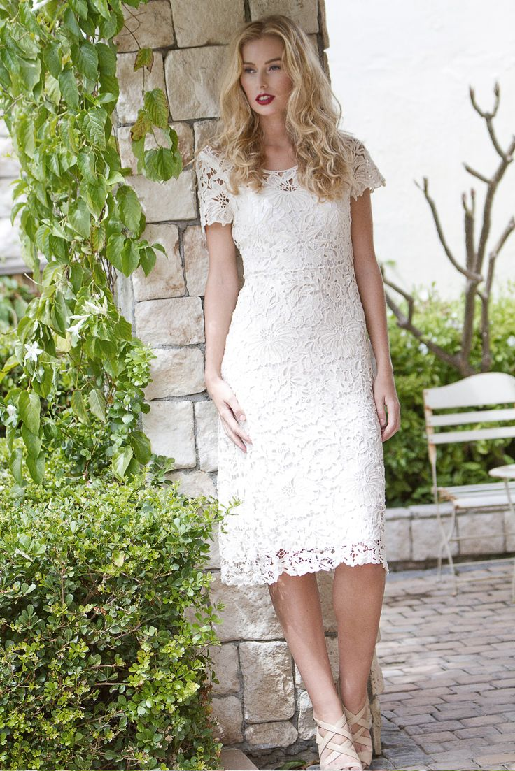 Island Lily's Prairie lace dress is irresistibly feminine.  The lightly scolloped hem give this piece a delicate finish.  Style yours with cut eye sunglasses and pointed pumps.