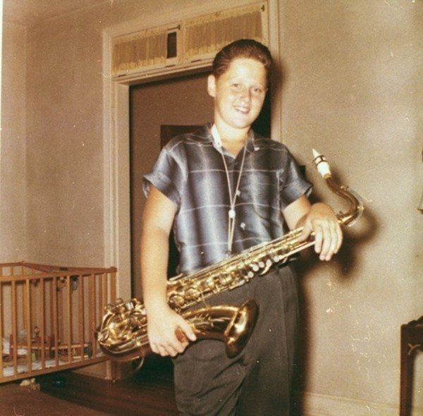 A young Bill Clinton with his saxophone 1960
