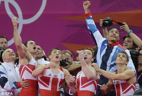 Jumping for joy: GB's gymnastics team (from left) Kristian Thomas, Sam Oldham, Daniel Purvis, Louis Smith and Max Whitlock celebrate