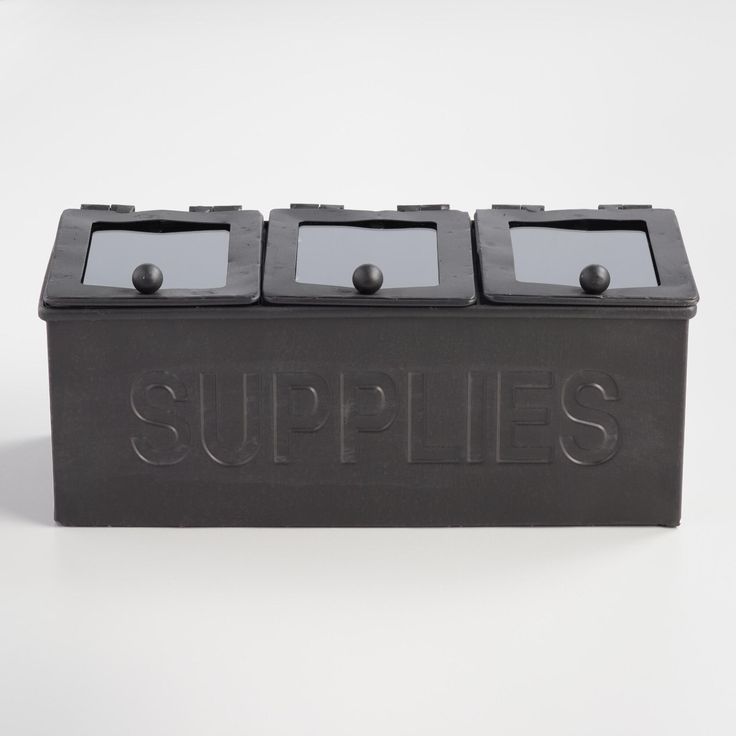 """Embossed with the word """"supplies,"""" our industrial metal box keeps everyday items handsomely stowed in the entryway, closet or home office. Sort odds and ends into its three roomy compartments, each neatly contained with a hinged, glass-topped lid."""