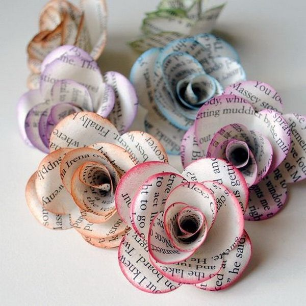 Colored Book Paper Flowers. These roses are made out of recycled vintage book pages and painted with watercolor.
