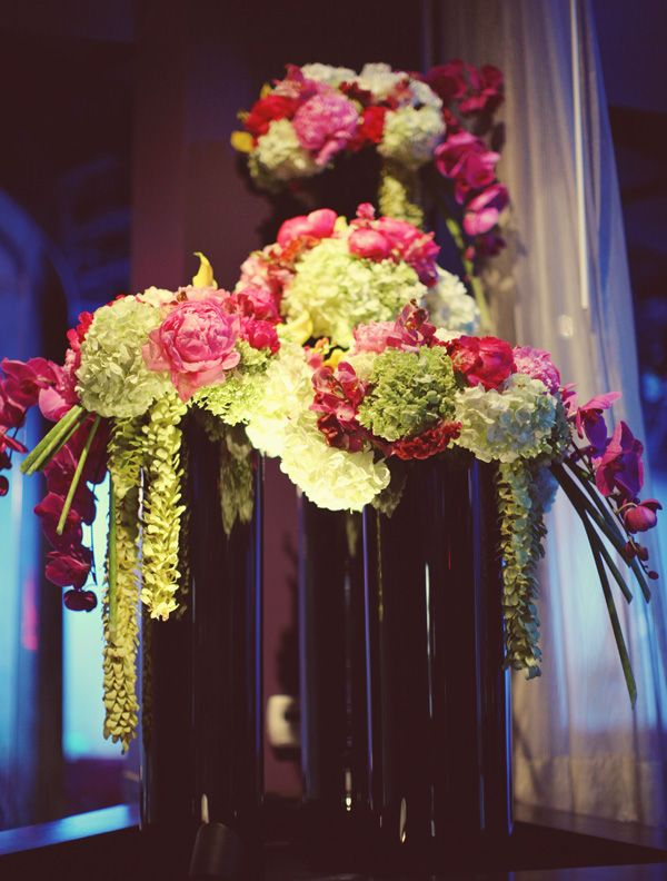 glam pink and green flower arrangements with pink peonies, orchids, and hydrangeas