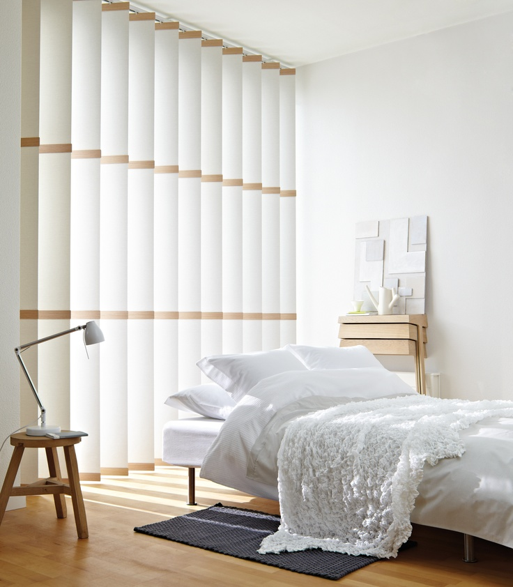 Subtle wood trim and soft look creates a elegant, simple look for this modern bedroom.  #home decor #bebroom #vertical blinds #luxaflex