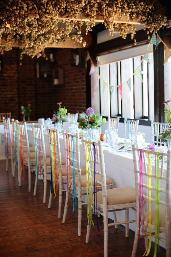 127 best events indoor event ideas images on pinterest chairs different coloured ribbon hanging from the reception venue chairs dasha caffrey a colourful village hall wedding in kent with lots of diy and a tea junglespirit Images