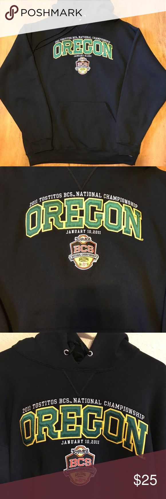 "University of Oregon Ducks Football Hoodie University of Oregon Ducks 2011 Tostitos BCS National Championship Hoodie.  This hoodie is black and size XL.    Measurements:  underarm to underarm across front: 25""   Length from back collar to hem: 29""  Condition: Appears unworn. This hoodie is in very good pre-owned condition.  Colors are bright.  No fading, holes or stains. Russell Athletic Jackets & Coats"