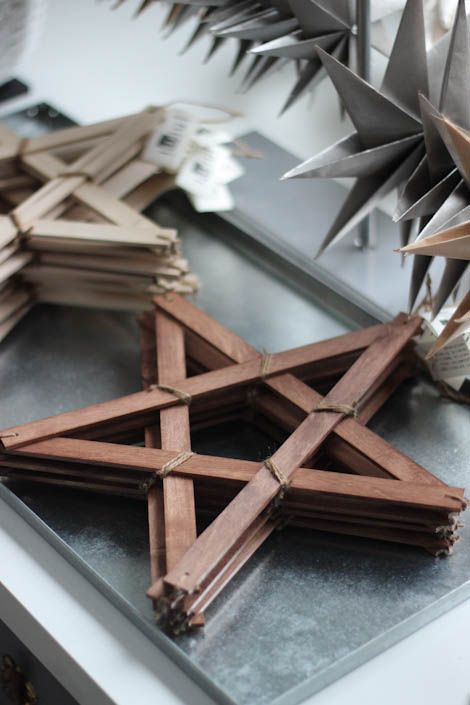 Wooden and paper stars as Christmas ornaments.  I'd like to make a Whole bunch of the wooden ones for our first Christmas in ur first home!