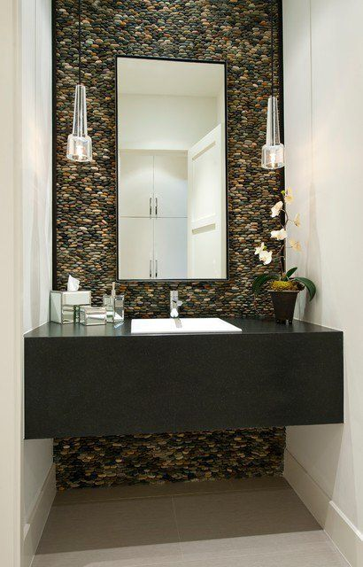 Beautiful powder room with marble subway tile backsplash and modern black bathroom vanity with gold wall-mount faucet with lever handles by Kohler. Description from pinterest.com. I searched for this on bing.com/images