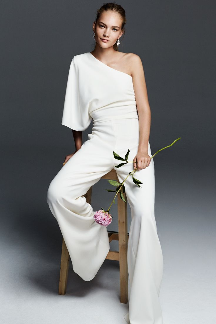 EUGENIA, one-shouldered romper in milk-white cady, with a roomy, asymmetrical drape. Tight in the waist then falling softly to the sleek and smooth trousers. A modern look pairing essential elegance with structure. #maxmarabridal #weddingdress #wedding