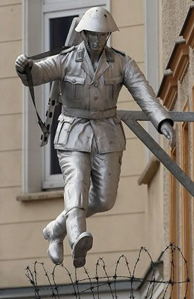A Statue Of East German Soldier Conrad Schumann Who