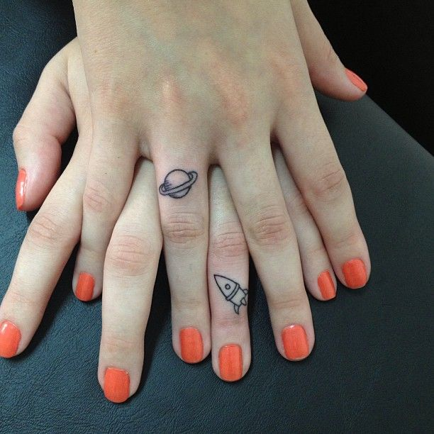 orange nails + little space tattoos.