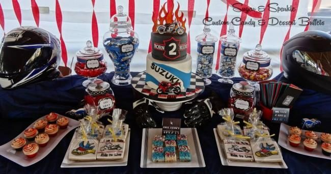 This boy's motorcycle birthday party features a delightful dessert table.