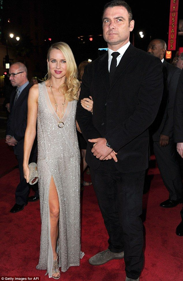 What's wrong Liev? Despite his wife looking sensational at the J. Edgar premiere in Los Angeles last night, Naomi Watts' husband Liev Schreiber appeared to be in another world as he posed with her on the red-carpet