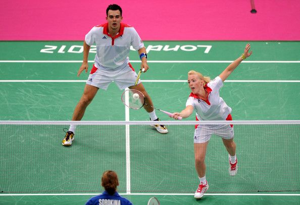 Chris Adcock (L) celebrates with teammate Imogen Bankier (R) of Great Britain return a shot against Alexandr Nikolaenko and Valeria Sorokina of Russia during their Mixed Doubles Badminton on Day 1 of the London 2012 Olympic Games at Wembley Arena on July 28, 2012 in London, England.