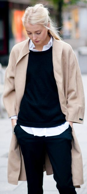 Trousers, white blouse layered underneath a black cashmere sweater, a classic carmel cashmere coat