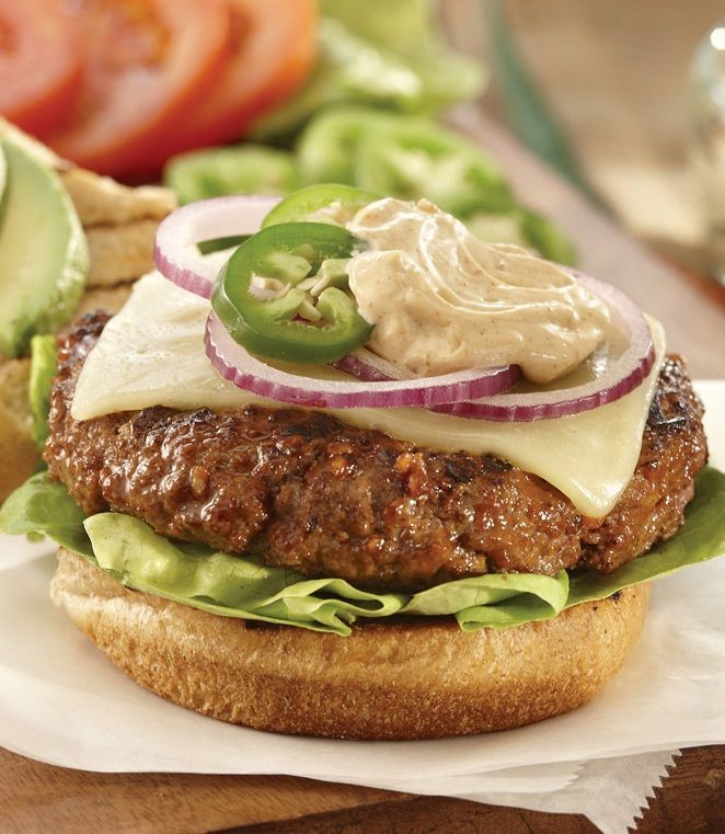 Top burgers with a spicy ranch sauce, made from mayo, sour cream and taco seasoning.