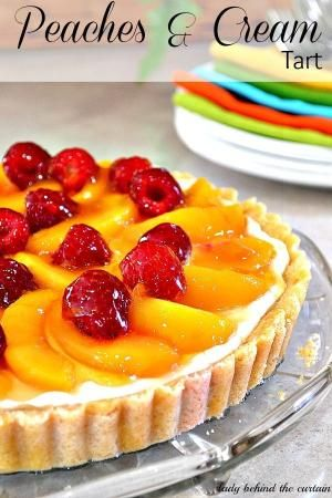 Peaches & Cream Tart ~ An almond and macaroon crust, filled with an almond flavored cream, topped with peaches and raspberries, and brushed with apricot preserves and honey...WOW! by bridgett