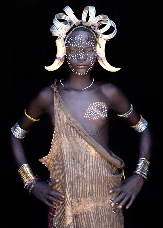 Africa | Young Mursi girl in Omo Valley, Ethiopia | ©John Kenny