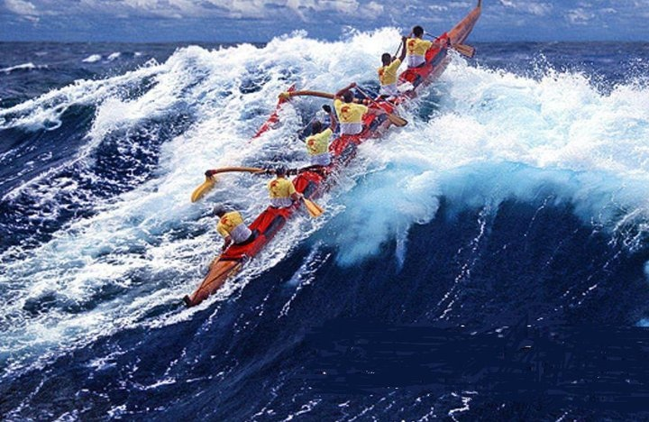 Kihei Canoe Club (Maui) men racing in a Koa canoe during epic conditions in the Ka'iwi Channel, early 2000's. Photographed by Shane Tegarden.
