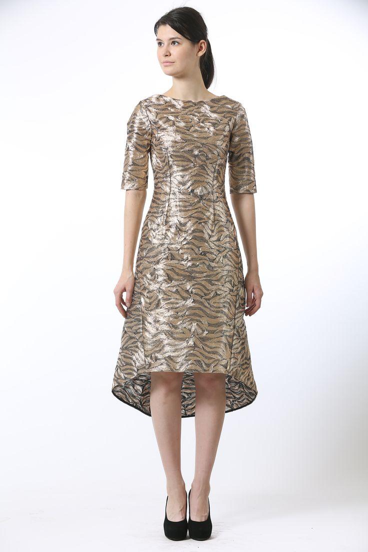 Gold metallic embroidered silk organza midi length dress featuring an asymmetrical hemline and an off center conceal zip bone detail.