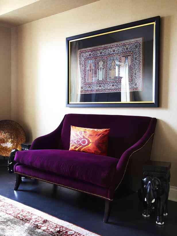 Danielle Colding HGTV Design Star   Framed Art Over Purple Velvet Settee