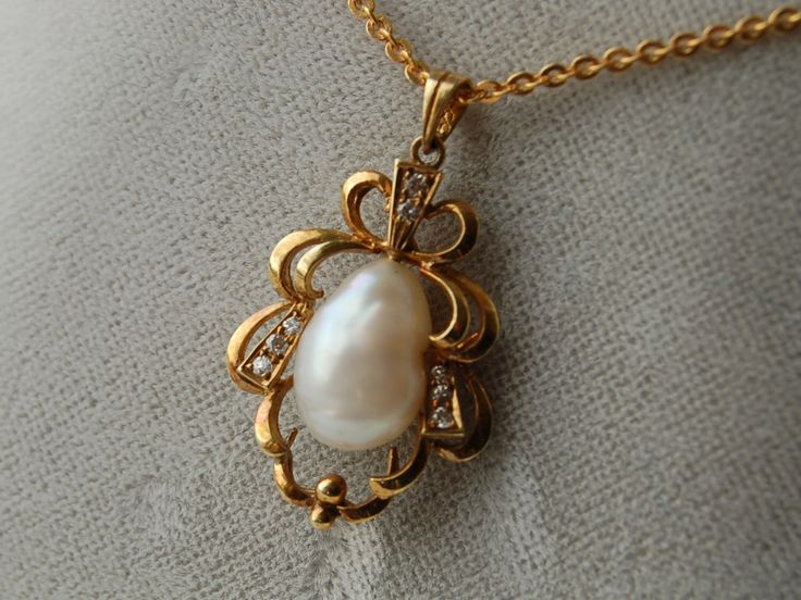 Freshwater pearl and diamond pendant 14k gold pendant 9k gold chain by nancyplage on Etsy https://www.etsy.com/listing/183208225/freshwater-pearl-and-diamond-pendant-14k