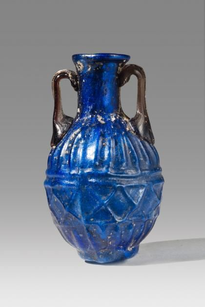Roman Blue Glass Amphoriskos | Vessels   Date:  1st Century AD Culture:  Roman Category:  Vessels Medium:  Glass