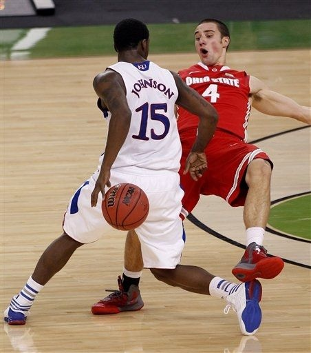 Aaron Craft The flopper    Kansas guard Elijah Johnson (15) dribbles around Ohio State guard Aaron Craft (4) during the first half of an NCAA Final Four semifinal college basketball tournament game Saturday, March 31, 2012, in New Orleans. (AP Photo/Bill Haber)