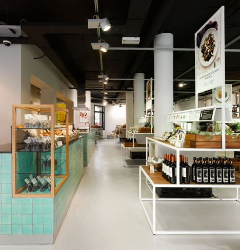 staat has designed the interior and branding for this alternative supermarket in Amsterdam, where ingredients are grouped together as recipes rather than food types