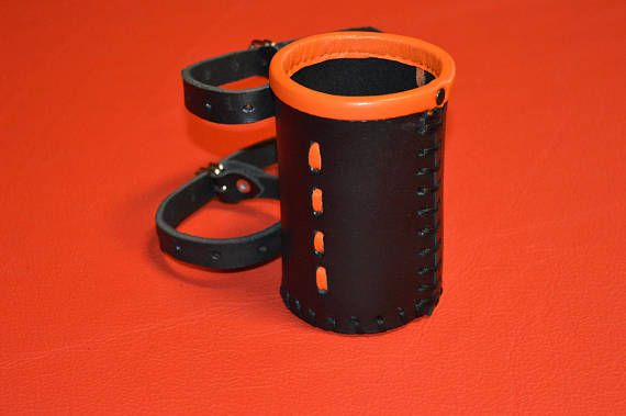 HANDMADE  MATERIAL: GENUINE LEATHER  11cm in hight  7,8cm in diameter  Leather thickness - 3,8 mm   High quality handmade Motorcycle cup holder.  Fork Bags not included.