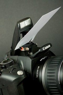 DIY and hacks for photography. 1. All you need is a white business card and a pair of scissors (knife, sharp edge, nail etc). Make two cuts on the other end of the card and install it to the metallic hinges of the integrated flash. You might even consider an angle near 45 degrees. :)