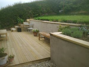 rendered concrete block wall with sandstone cap