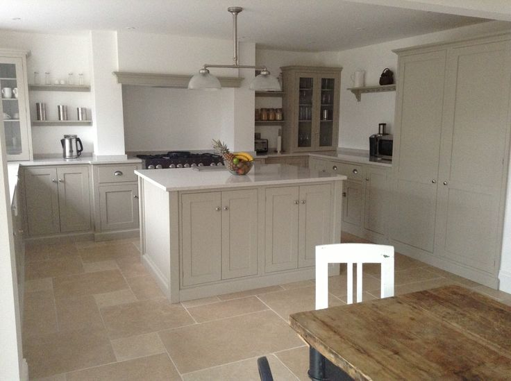 The beautiful Dijon Tumbled Limestone with a mushroom coloured deVOL kitchen.