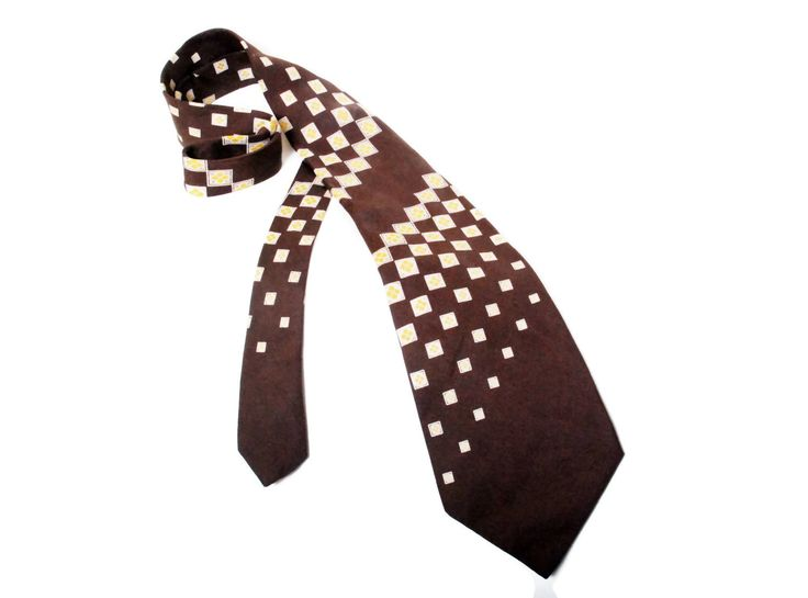 Vintage original brown tie made by France. Tie is well made, unfortunately tie has small hole on the front, but its bearly noticable.  Total lenght: 145 cm / 57 inches Max Width: 11.5 cm / 4.5 inches Min Width: 3 cm / 1.1 inch  Fabric: 100% Silk Condition: very good Colors: Brown, Beige, Yellow  More vintage accessories: https://www.etsy.com/shop/SixVintageChicks?section_id=17732246&ref=shopsection_leftnav_10  Check out my shop! https:/&#x...