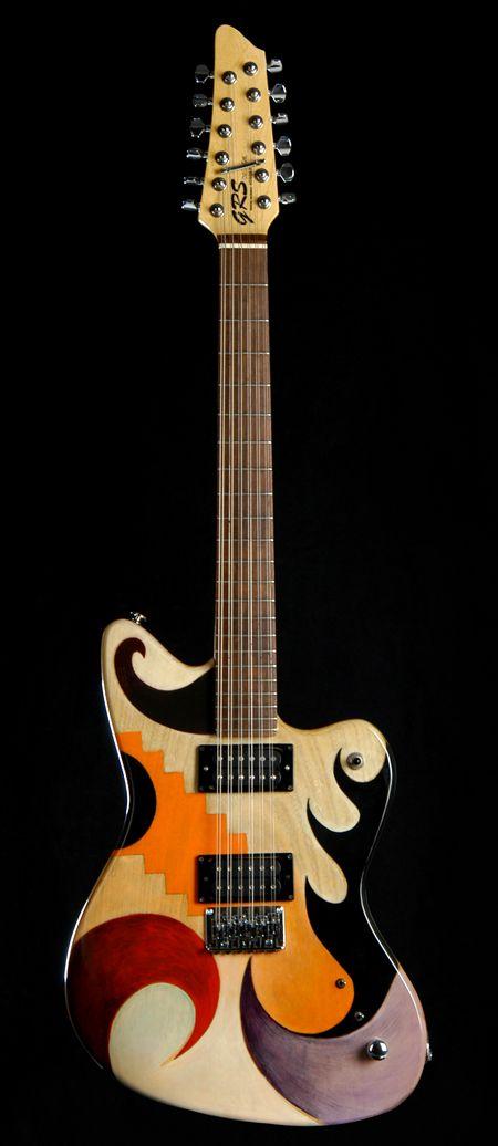 Une magnifique fresque boisée de chez GRS Custom. Retrouver des cours de guitare d'un nouveau genre sur MyMusicTeacher.fr