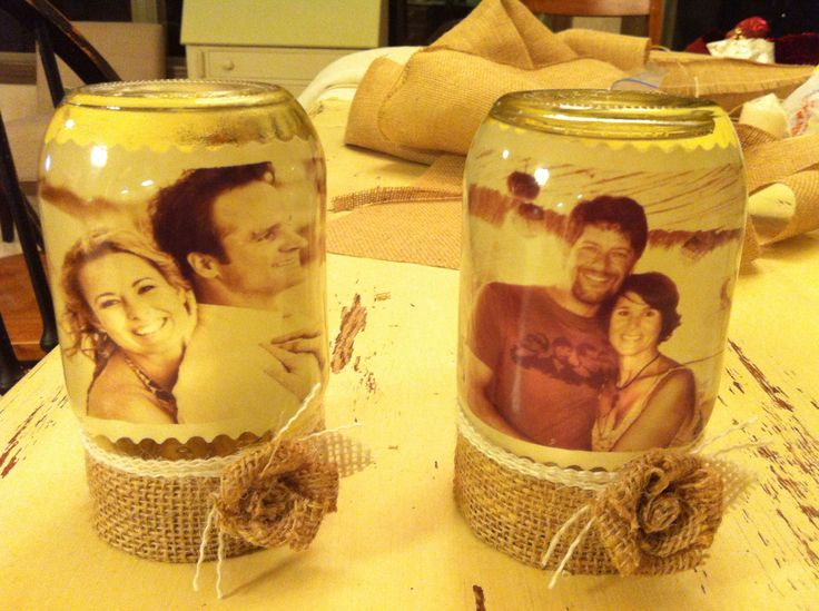 Found this project on Pinterest last december. You put oil in mason jars and float the picture in it, assembling it upside down. Was on a burlap kick, so I decorated with that to hide the lid of the jar.  The oil preserves the pictures.