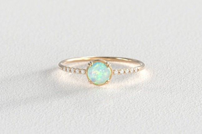 16 Opal Engagement Rings You'll Fall in Love With | Brit + Co anillos de compromiso | alianzas de boda | anillos de compromiso baratos http://amzn.to/297uk4t