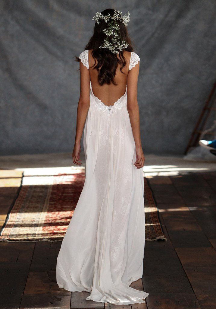 Phaedra a boho wedding dress that belongs on the beach or in a glorious field. Flowing chiffon over-skirt over lace details is just begging for a soft breeze.