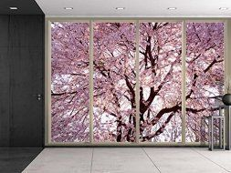 Japanese Wall décor is truly mystical, enchanting and  beautiful. Chances are you have seen  those pretty Japanese wall fans or a captivating cherry blossom painting. Either way Japanese home wall art décor is  stylish, unique and very popular in homes across the USA.   Wall26 - Branches Filled with Pink Cherry Blossom Flowers Viewed From Sliding Door - Creative Wall Mural, Peel and Stick Wallpaper, Home Decor - 100x144 inches