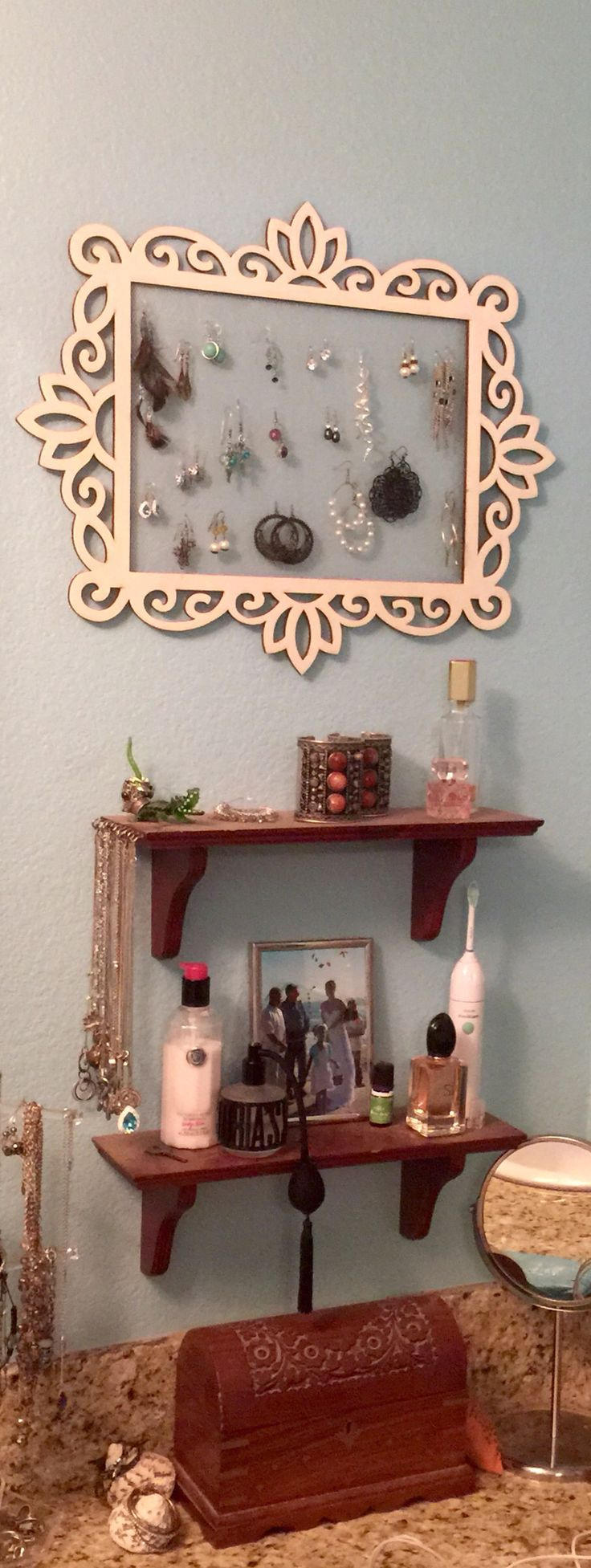 Jewelry displays...hooks fastened into shelving for necklaces and a wooden frame with a screen back for earrings!