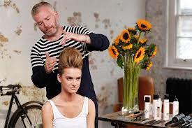 Adam Reed styling hair.
