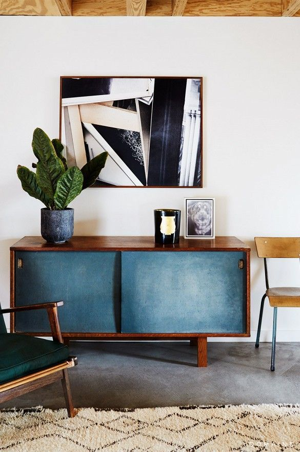 A mix of minimalist and eclectic style. Neutral shades create a home of tranquility whilst the abstract art against the vintage blue sideboard compliment each other beautifully. Together, they create a warm, inviting home.