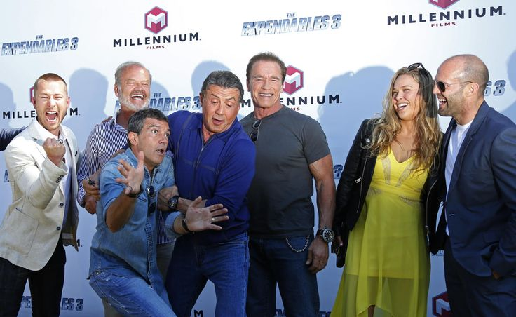 "(L-R) Cast members Glen Powell, Kelsey Grammer, Antonio Banderas, Sylvester Stallone, Arnold Schwarzenegger, Ronda Rousey and Jason Statham pose during a photocall on the Croisette to promote the film ""The Expendables 3"" during the 67th Cannes Film Festival in Cannes May 18, 2014."